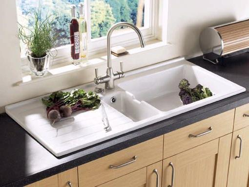 Example image of Astracast Sink Jersey 1.5 bowl sit-in ceramic kitchen sink with left hand drainer.